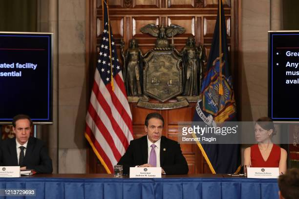 New York State Heath Commissioner Howard A Zucker MD JD New York Governor Andrew Cuomo and Secretary to the Governor Melissa DeRosa attend the...