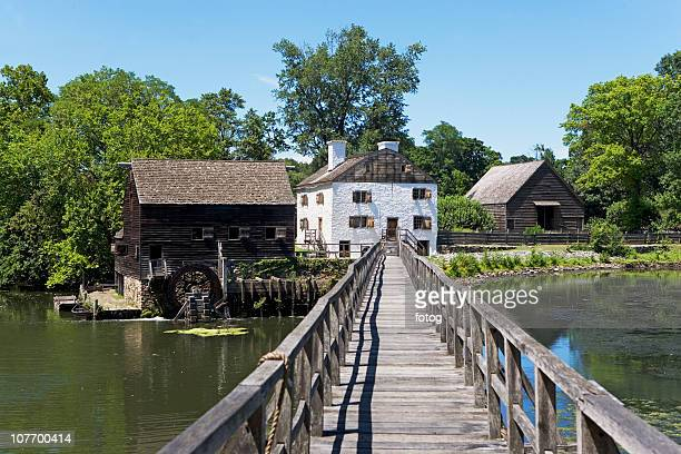USA, New York State, Hudson Valley, Philipsburg Manor, Sleepy Hollow, historical footbridge and buildings