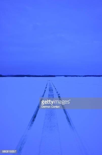 USA, New York State, Lake Champlain, Snowmobile tracks on frozen lake
