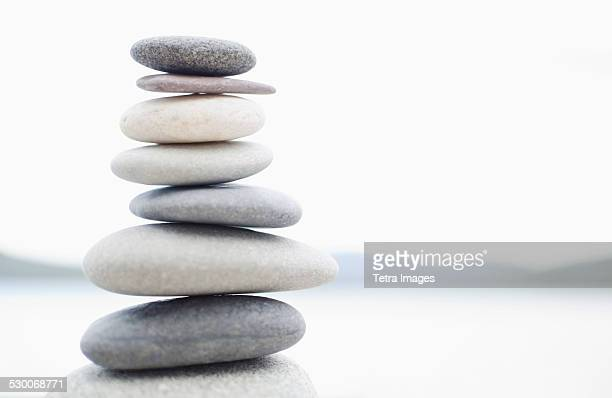 usa, new york state, lake placid, stacked pebbles - pebble stock photos and pictures