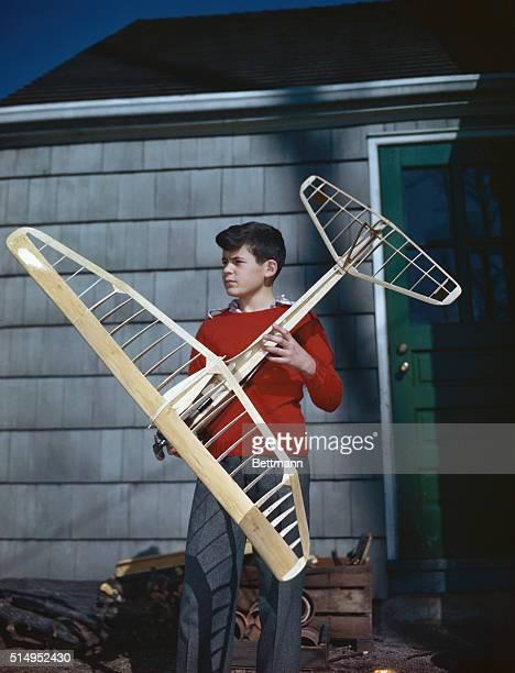 New York State, Long Island, North Hempstead, Port Washington, Boy holding model airplane