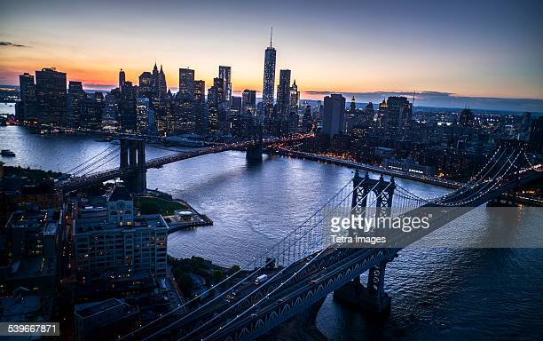 USA, New York State, New York City, Aerial view of city with Freedom tower at sunset