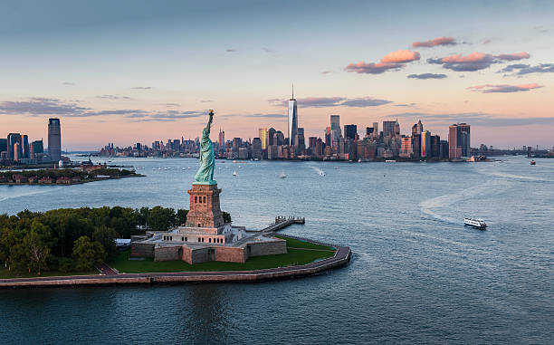 USA, New York State, New York City, Aerial View Of City With Statue Of Liberty At Sunset Wall Art