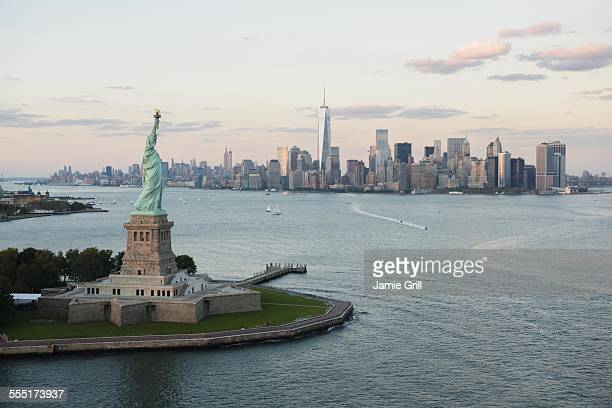 USA, New York State, New York City, Aerial view of Statue of Liberty and city skyline
