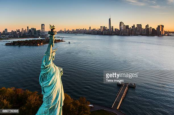 usa, new york state, new york city, aerial view of statue of liberty at sunrise - statue of liberty stock pictures, royalty-free photos & images