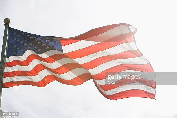 USA, New York State, New York City, American flag against sky