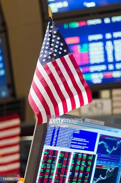USA, New York State, New York City, American flag on trading desk