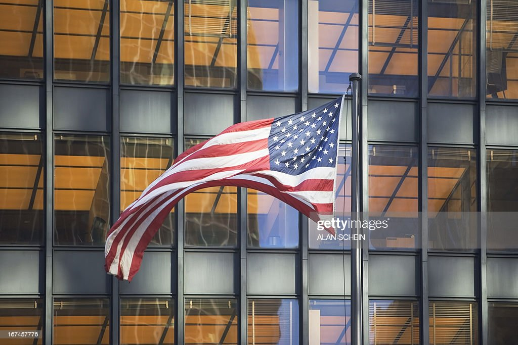 USA, New York State, New York City, American flag with building in background : Stock Photo