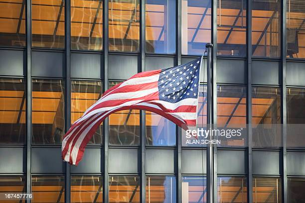 USA, New York State, New York City, American flag with building in background
