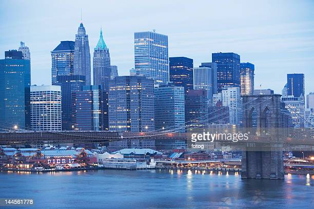 usa, new york state, new york city, brooklyn bridge and cityscape at night - south street seaport stock photos and pictures