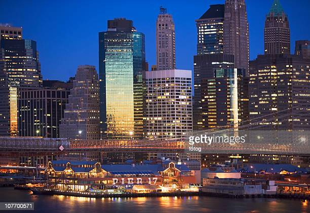 usa, new york state, new york city, brooklyn bridge and manhattan skyline at night - south street seaport stock photos and pictures