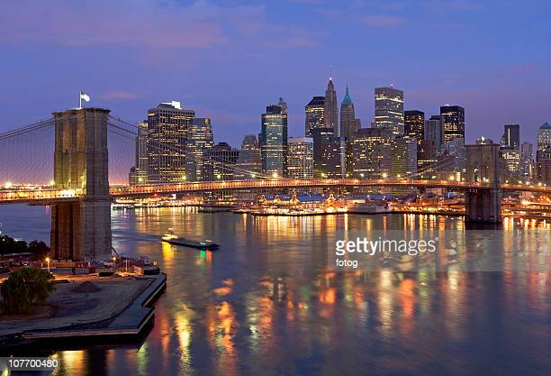 usa, new york state, new york city, brooklyn bridge and manhattan skyline illuminated at dusk - state stock pictures, royalty-free photos & images