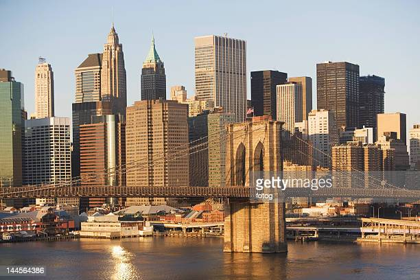 usa, new york state, new york city, brooklyn bridge with skyscrapers - south street seaport stock photos and pictures