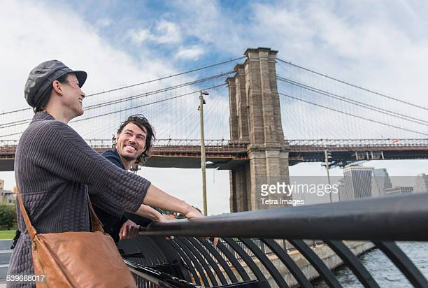 USA, New York State, New York City, Brooklyn, Couple leaning against railing