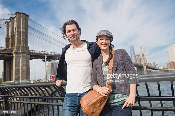 USA, New York State, New York City, Brooklyn, Couple leaning against railing and looking at camera