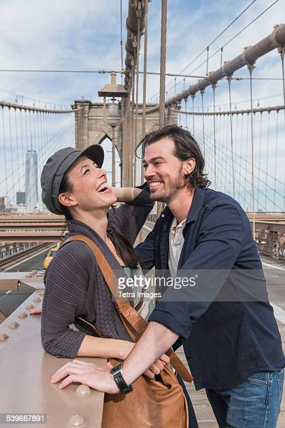 USA, New York State, New York City, Brooklyn, Happy couple flirting on Brooklyn Bridge