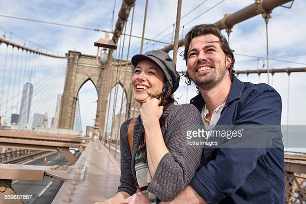 USA, New York State, New York City, Brooklyn, Happy couple on Brooklyn Bridge