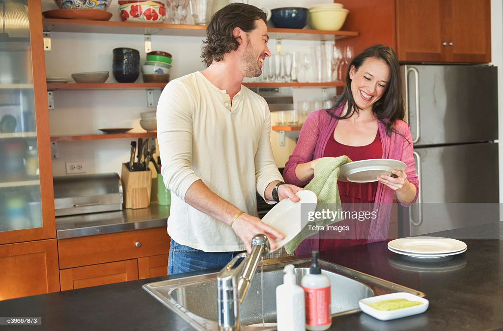 USA, New York State, New York City, Brooklyn, Happy couple washing dishes : Stock Photo