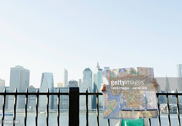USA, New York State, New York City, Brooklyn, Woman holding map