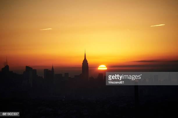USA, New York State, New York City, Cityscape with Empire State building at sunrise