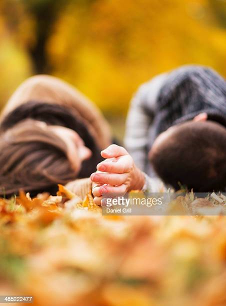 usa, new york state, new york city, couple lying down in central park - lying in state stock pictures, royalty-free photos & images