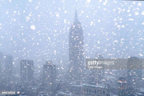 USA, New York State, New York City, Empire State Building and city skyline in snow