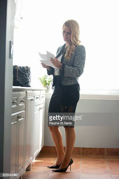 usa, new york state, new york city, long island city, businesswoman standing in kitchen - lace skirt stock photos and pictures
