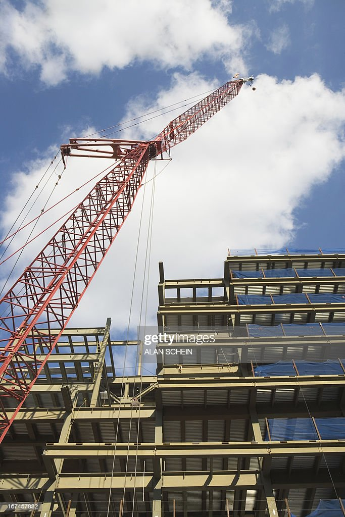 USA, New York State, New York City, Low angle view of crane and building under construction : Stock Photo