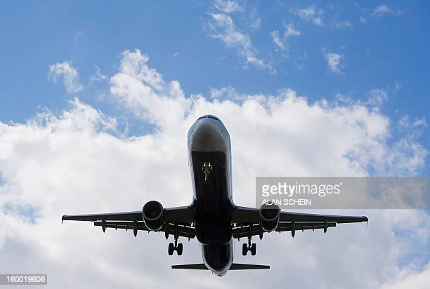 usa, new york state, new york city, low angle view of flying airplane - laguardia airport stock pictures, royalty-free photos & images