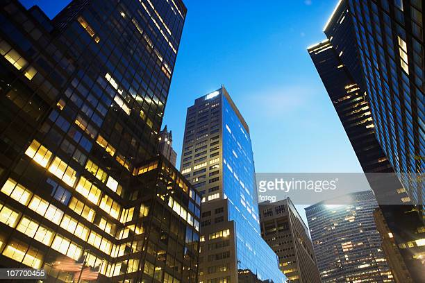 usa, new york state, new york city, low angle view of skyscrapers at twilight - state stock pictures, royalty-free photos & images