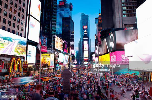 USA New York State New York City Manhattan Crowds of tourists in illuminated Times Square at night