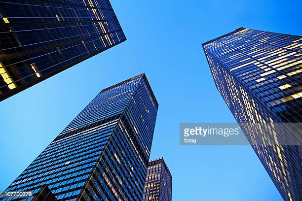 usa, new york state, new york city, manhattan, low angle view of office buildings illuminated at dusk - state stock pictures, royalty-free photos & images
