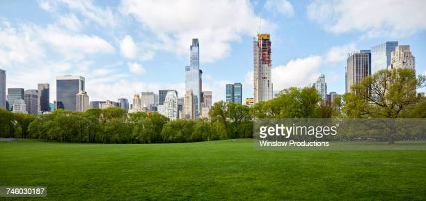 usa, new york state, new york city, manhattan skyline with central park in foreground - public park stock pictures, royalty-free photos & images