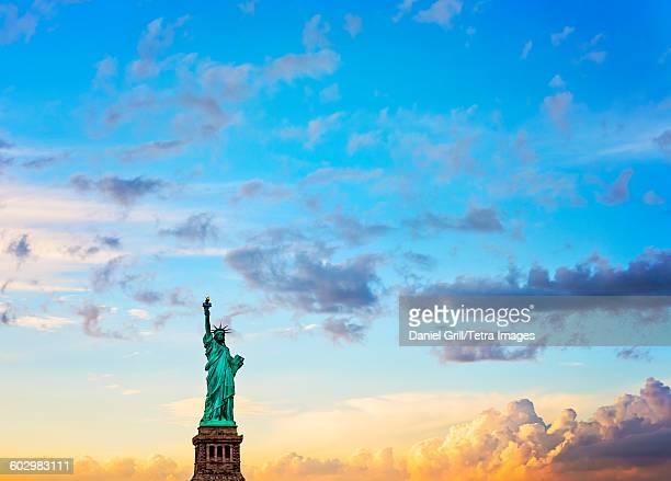 USA, New York State, New York City, Manhattan, Statue of Liberty at sunset