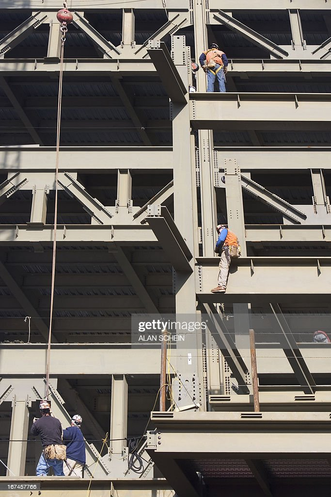 USA, New York State, New York City, Men working on construction frame : Stock Photo