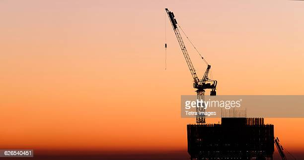 USA, New York State, New York City, Silhouette of skyscraper under construction