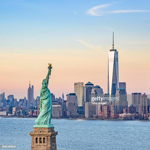 usa, new york state, new york city, statue of liberty and one world trade centre - statue of liberty stock pictures, royalty-free photos & images