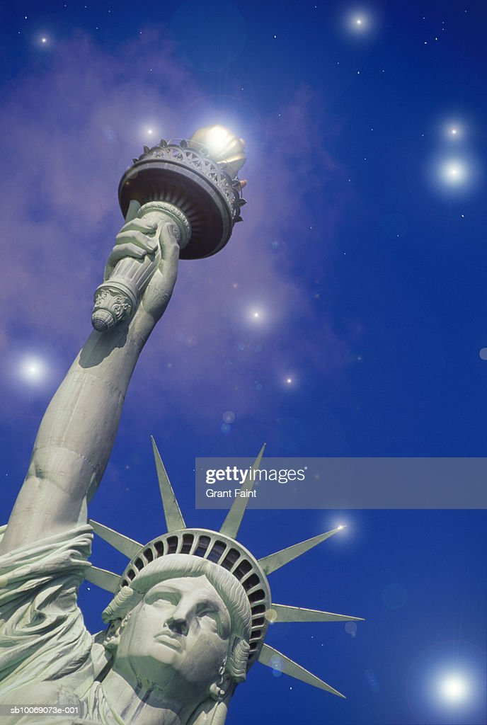 USA, New York State, New York City, Statue of Liberty with stars in sky, low angle view : Stockfoto