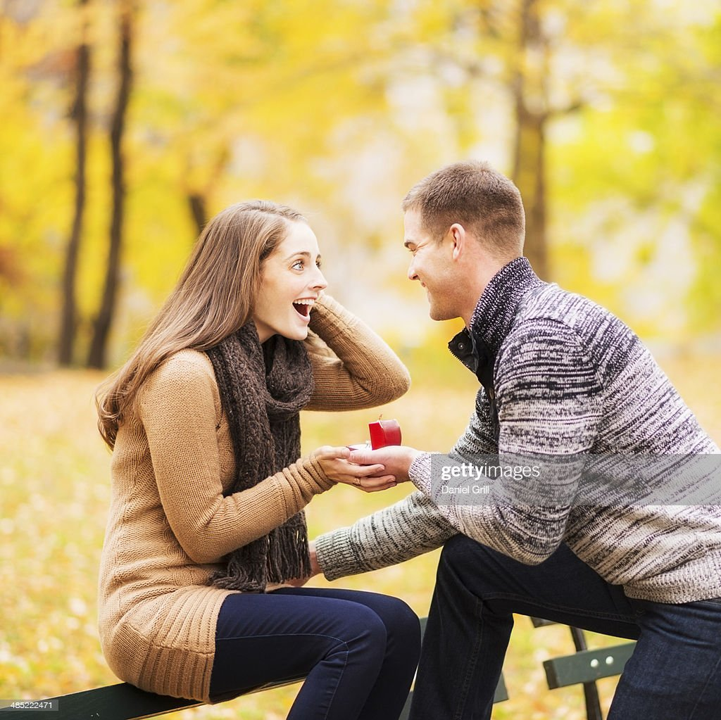 USA, New York State, New York City, Young man proposing to young woman in Central Park : Stock Photo