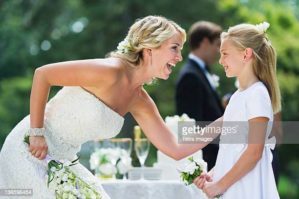 usa, new york state, old westbury, bride with flower girl (10-11) at wedding reception - bridesmaid stock pictures, royalty-free photos & images