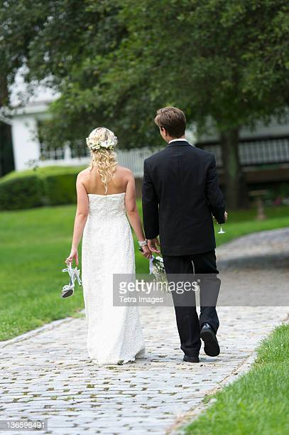 USA, New York State, Old Westbury, Newly wed couple walking together