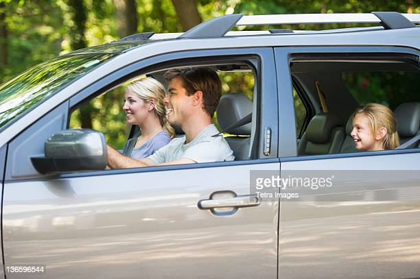 usa, new york state, old westbury, parents with daughter (10-11) driving car - family driving stock photos and pictures