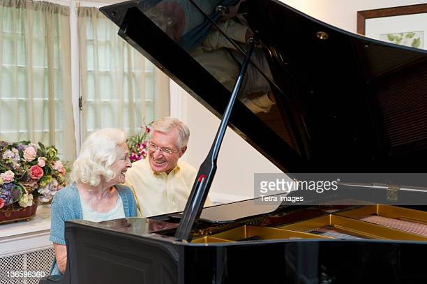 usa, new york state, old westbury, senior couple playing piano - grand piano stock pictures, royalty-free photos & images