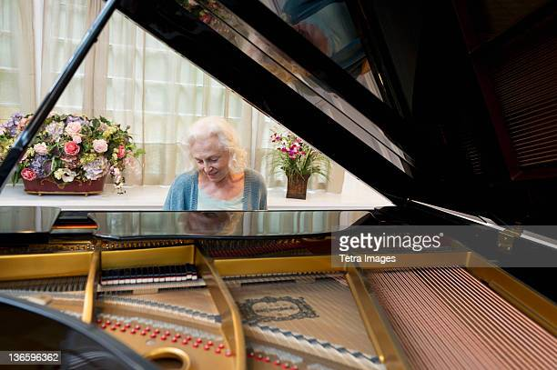 usa, new york state, old westbury, senior woman playing piano - grand piano stock pictures, royalty-free photos & images