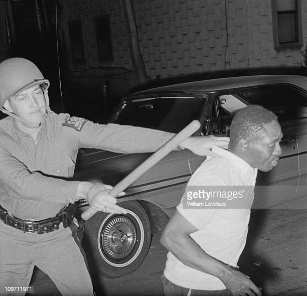 New York State Police officer restrains a man during the race riot in Rochester, New York State, late July 1964.