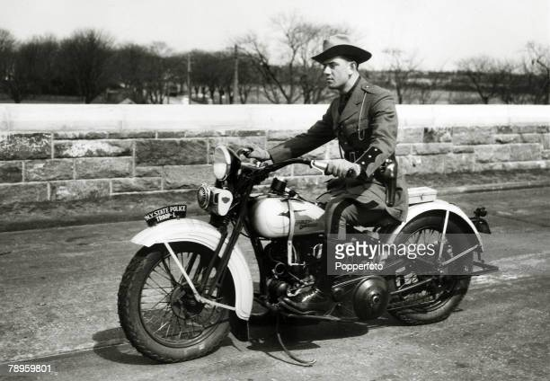 Law and OrderTransport Motorcycles pic circa 1940 A New York State policeman in summer uniform riding a Harley Davidson motorcycle on the Northern...