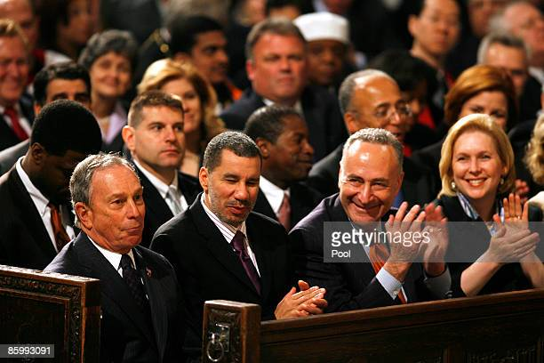 New York state politicians New York City Mayor Michael Bloomberg Governor David Paterson Sen Charles Schumer and Sen Kirsten Gillibrand sit in a pew...