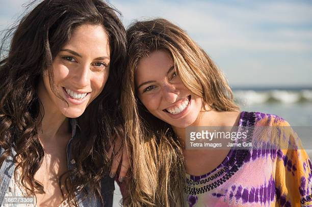 USA, New York State, Rockaway Beach, Portrait of two young women on beach