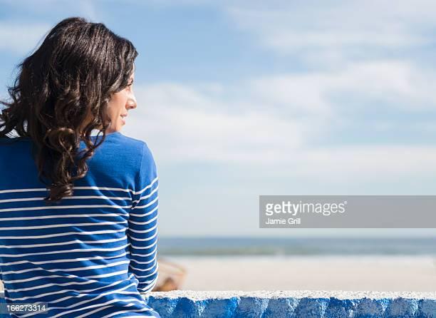 USA, New York State, Rockaway Beach, Woman relaxing on beach