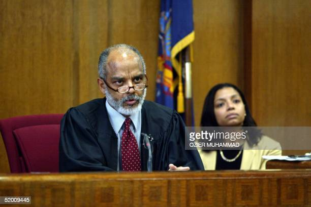 New York State Supreme Court Justice Charles Tejada speaks 19 December during proceedings in Lower Manhattan in which he dismissed the convictions of...